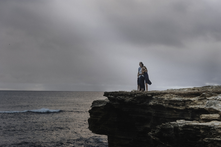 Adventure awaits family standing on cliff looking out at Hawaii islands